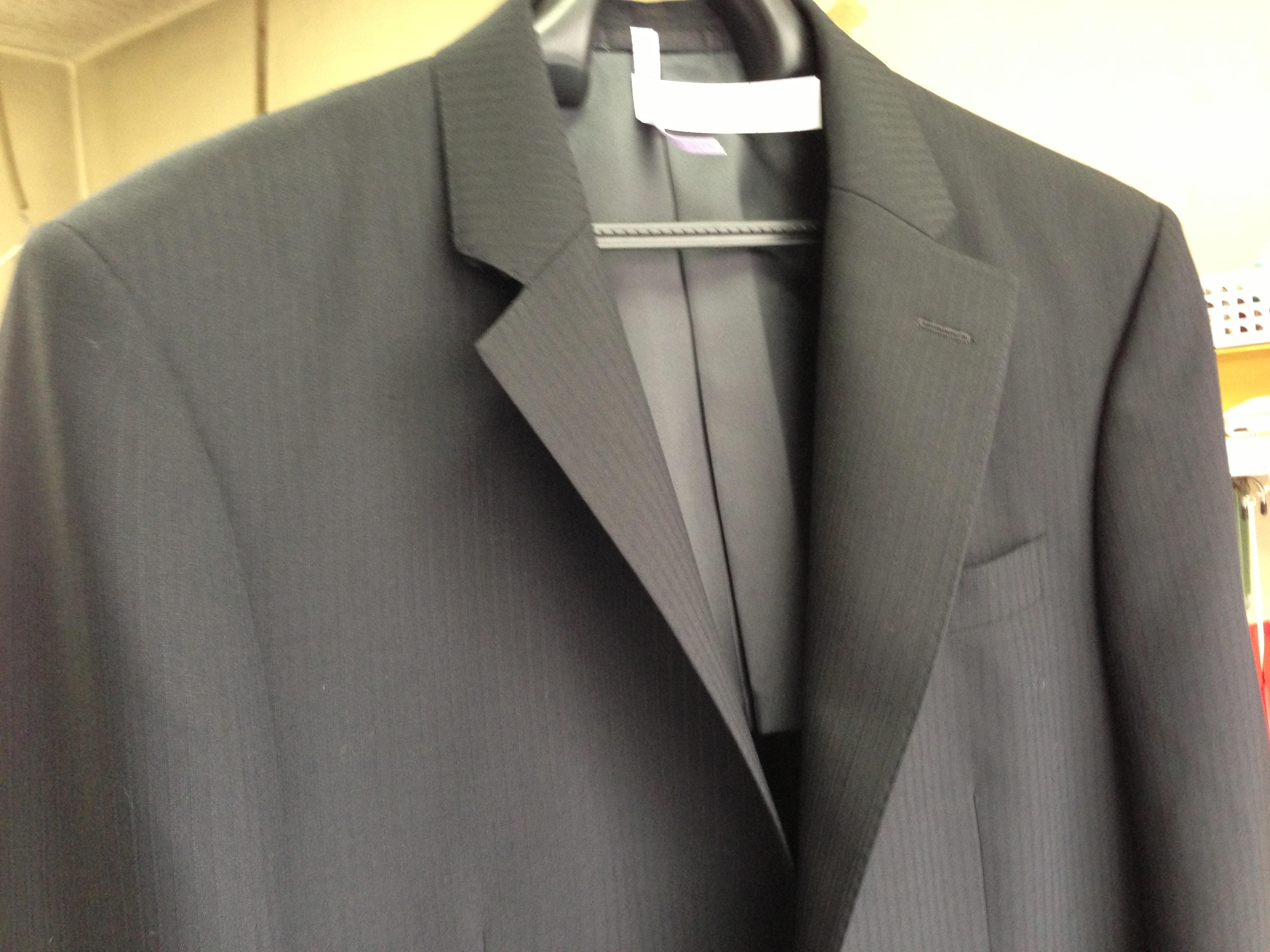 手仕上げ後のスーツ